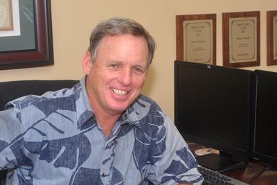 Darren Schneck at his desk